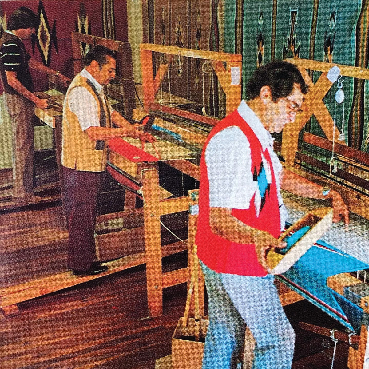 Men working looms in northern New Mexico