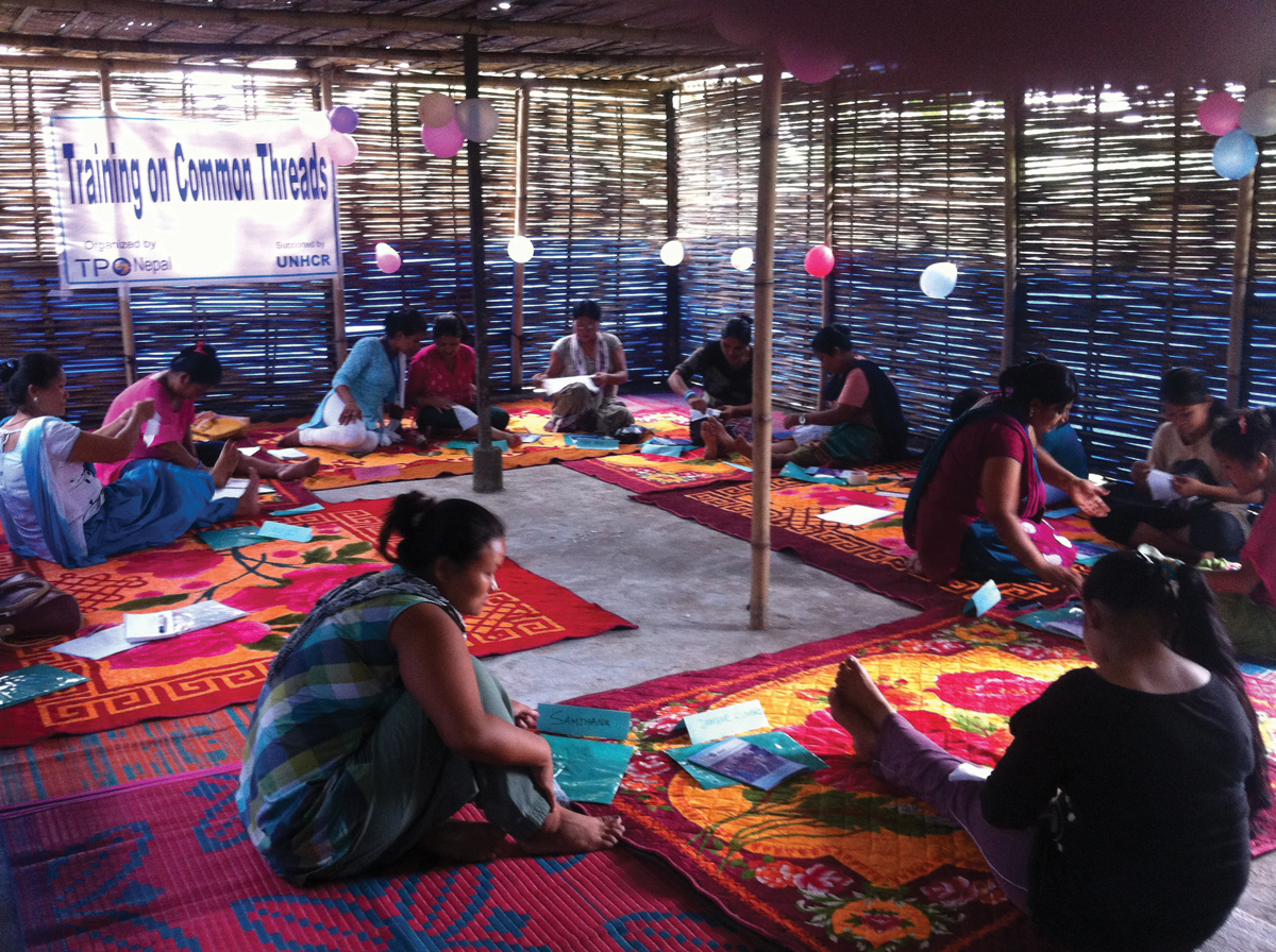 "Women talk in small groups at a Sajha Dhago (""common threads"" in Nepali) circle in Nepal."