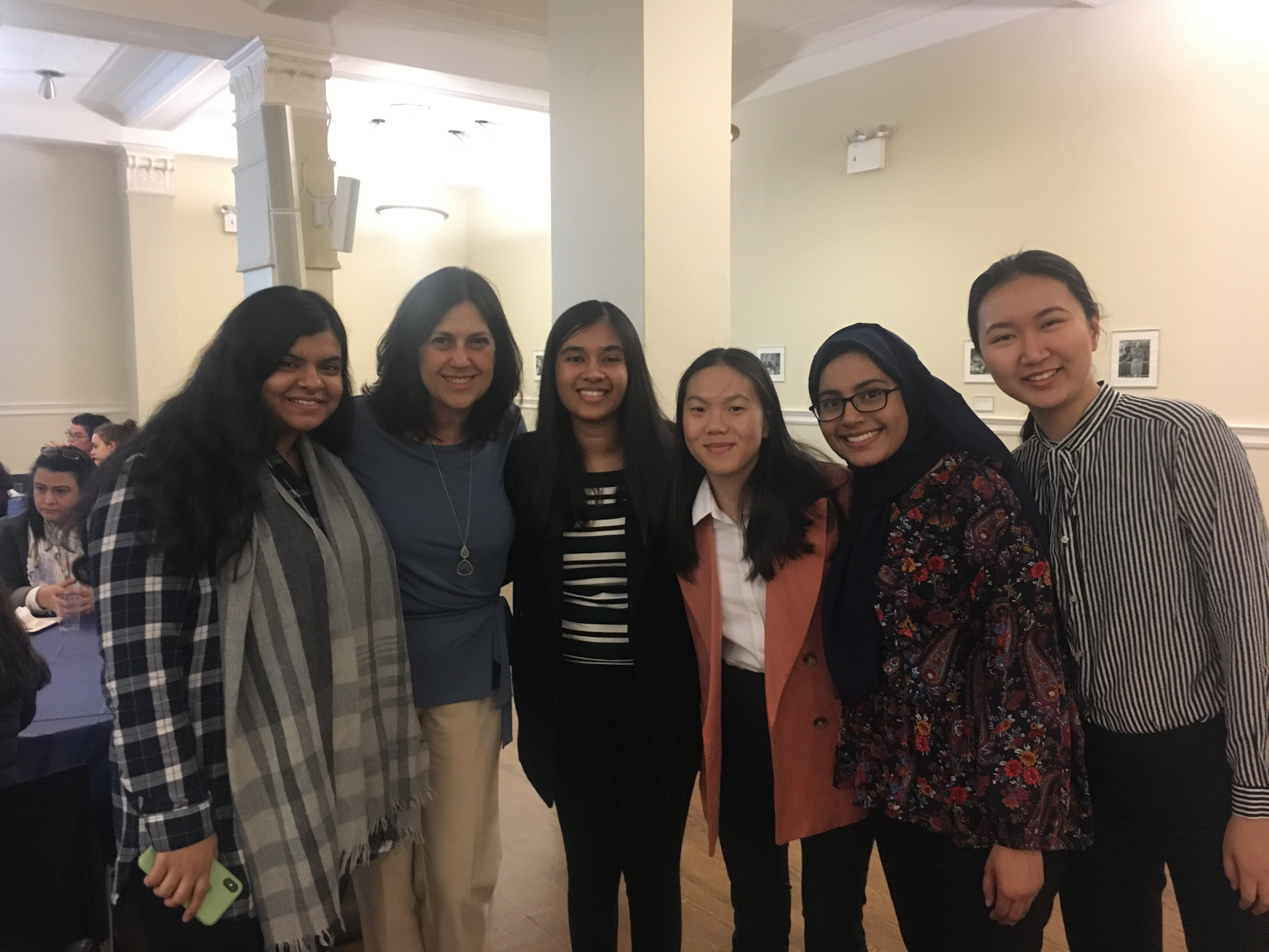 Group of students and alumnae at a health professions event.