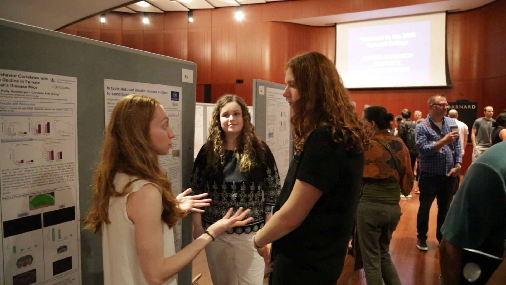 Students discussing research at the 2018 Poster Session