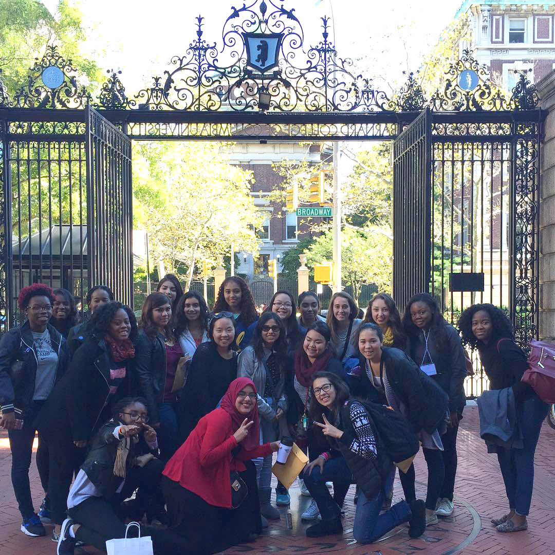 Barnard Bound students standing in front of main Barnard gates