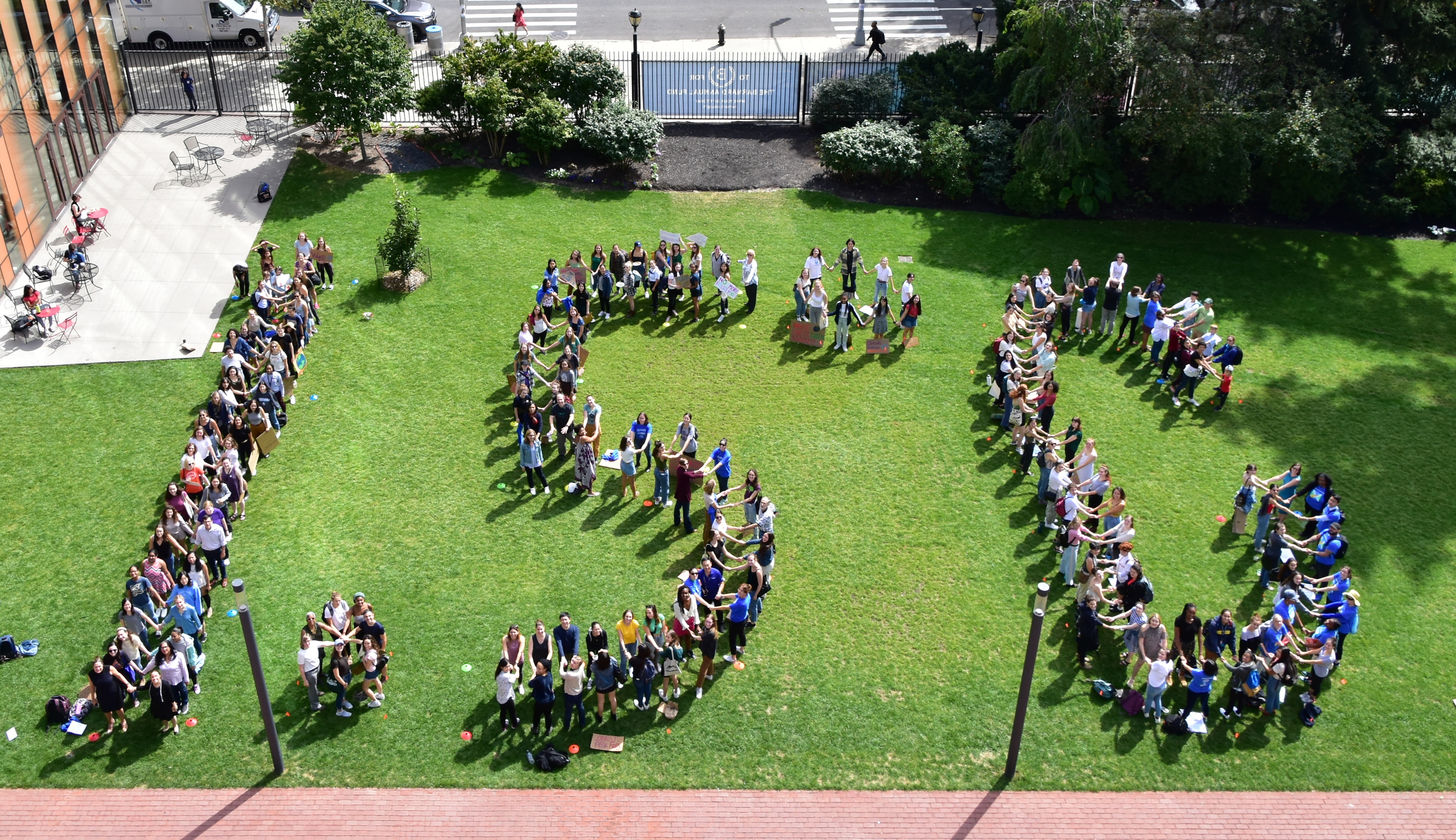 Students pose in the shape of 1.5 degrees celsius on the day of the climate strike