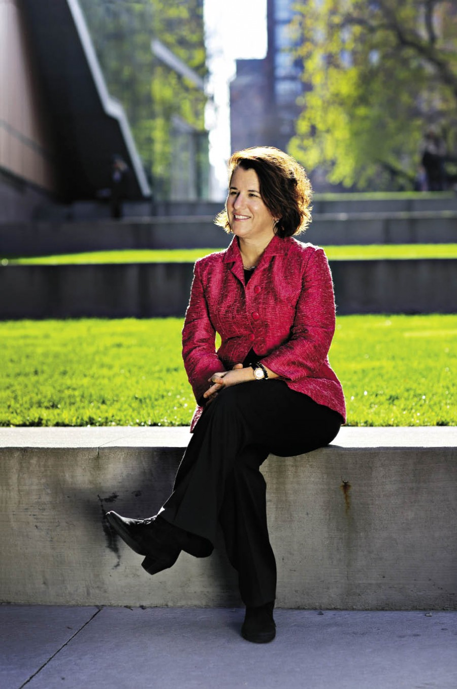Provost Linda Bell sitting outside Barnard Campus