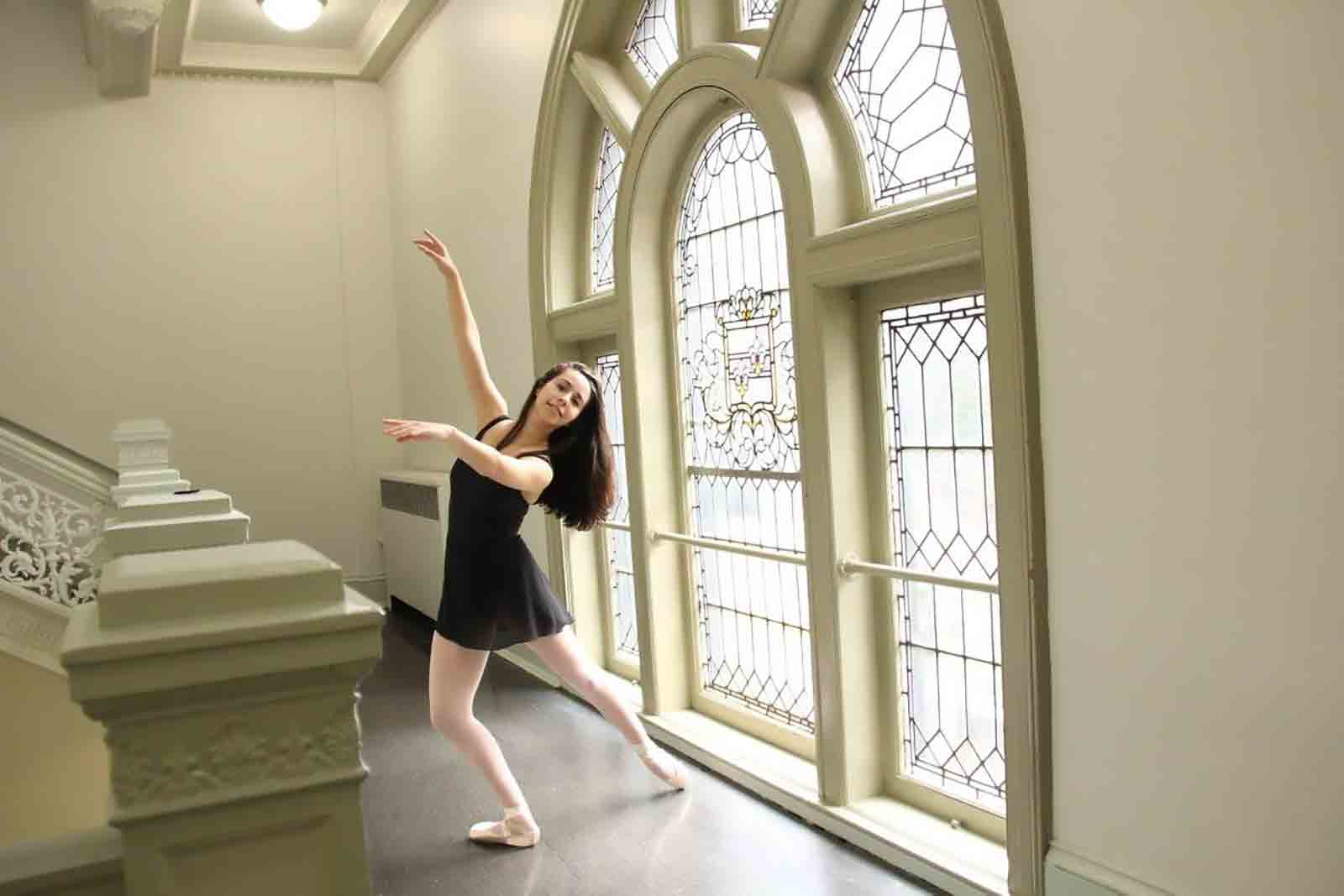 Young woman dancing near staircase