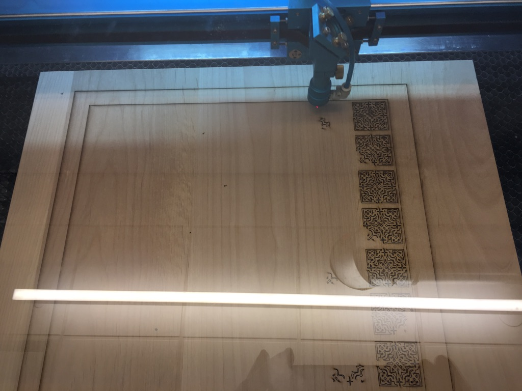 The chess board in the process of being cut by the laser cutter.
