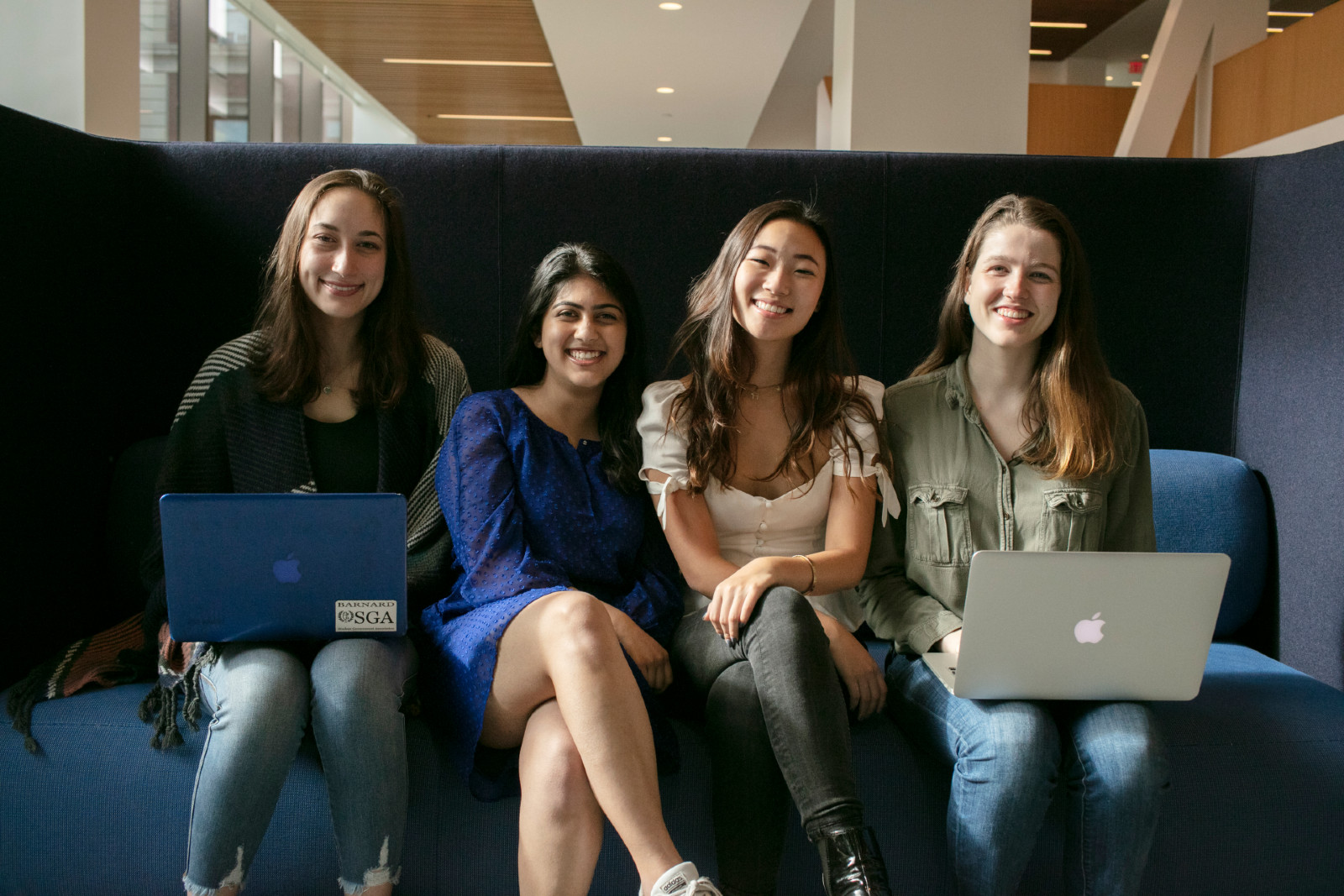 students on couch in milstein center