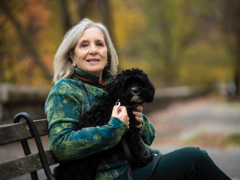Mary Gordon photo on a park bench with her dog