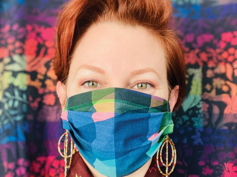 A woman wearing a colorful fabric mask